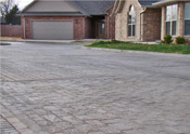 stamped concrete driveway and street in austin contractor example image