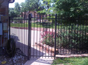 simple wrought iron fence and gate