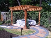 Stone path with wood pergola in Austin