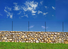 stone wall with wire top